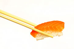 Sushi in Chopsticks Royalty Free Stock Photo