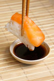 Sushi with chopsticks. And sauce Royalty Free Stock Image