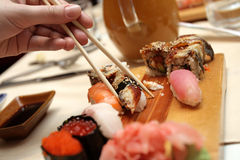 Sushi and chopsticks Stock Images