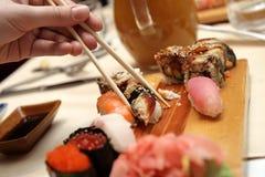Sushi and chopsticks. The sushi and chopsticks in japan restaurant Stock Images