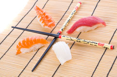 Sushi with chopsticks Stock Images