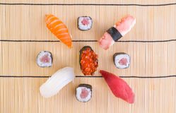 Sushi with chopsticks Royalty Free Stock Photos