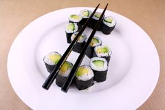 Sushi with chopsticks as a dollar sign Stock Image