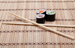 Sushi and chopsticks on bamboo mat Royalty Free Stock Images
