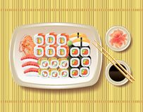Sushi and chopsticks on bamboo mat Royalty Free Stock Image
