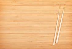 Sushi chopsticks on bamboo table Stock Photo