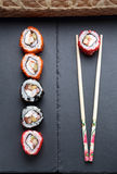 Sushi with chopsticks Royalty Free Stock Photography