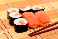 Sushi with chopsticks. Group of sushi with chopsticks Royalty Free Stock Images