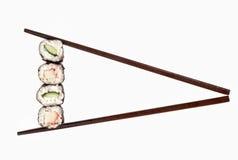 Sushi. With chopsticks isolated on white background royalty free stock photography