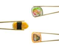 Sushi in chopsticks isolated on white Royalty Free Stock Image