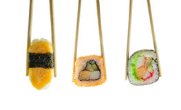 Sushi in chopsticks isolated on white Stock Photography