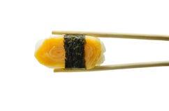 Sushi in chopsticks isolated on white Royalty Free Stock Photo