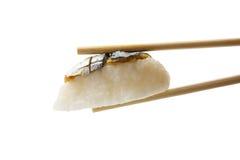 Sushi in chopsticks isolated on white background Royalty Free Stock Photo