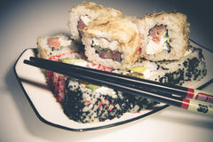 Sushi and chopsticks. Lying on a white plate Stock Photography
