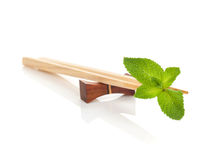 Sushi chopsticks with mint leaves Stock Photos