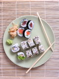 Sushi and chopsticks on plate Royalty Free Stock Photo