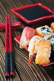 Sushi and chopsticks on a red plate Royalty Free Stock Image