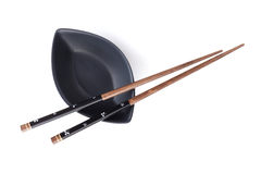 Sushi chopsticks and soy sauce bowl Royalty Free Stock Images