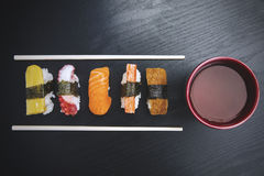 Sushi with chopsticks and soy on the table Royalty Free Stock Photos