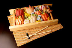Sushi with chopsticks. Traditional japanese food sushi, rolls on a plate royalty free stock images