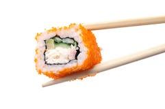 Sushi and chopsticks on white Stock Photo
