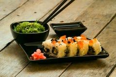 Sushi and chuka seaweed salad with soy sauce Royalty Free Stock Photo