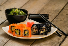 Sushi and chuka seaweed salad with soy sauce Royalty Free Stock Photography