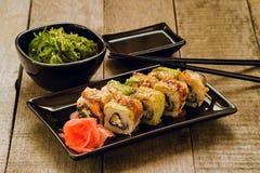 Sushi and chuka seaweed salad with soy sauce Stock Image