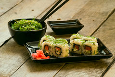 Sushi and chuka seaweed salad with soy sauce. On wooden table Stock Photos