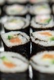 Sushi Closeup. Homemade sushi, made with rice, smoked salmon or surimi, avocado and cucumber Stock Image