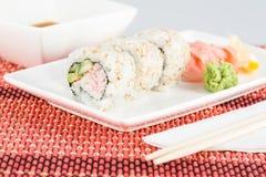 Sushi closeup with sticks, sauce Stock Image