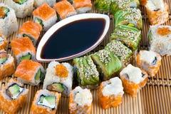 Sushi collecti. Sushi. Closeup japanese sushi on a bamboo napkin. Sushi collection Royalty Free Stock Photo