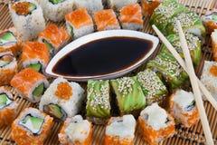 Sushi collecti. Sushi. Closeup japanese sushi on a bamboo napkin. Sushi collection Stock Image