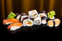 Sushi collection, isolated on black background. Asia cuisine Royalty Free Stock Photos
