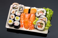 Sushi collection, isolated on black background. Asia cuisine Royalty Free Stock Images