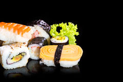 Sushi collection, isolated on black background. Royalty Free Stock Photo