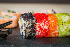 Sushi with colorful flying fish eggs Stock Image