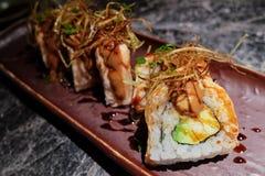 Sushi com molho do ovo do abacate e dos gras de Foie fotografia de stock