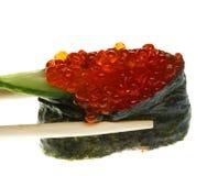 Sushi com os chopsticks disparados no branco Imagem de Stock Royalty Free