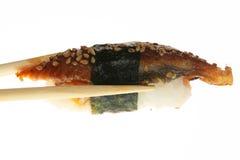 Sushi com os chopsticks disparados no branco Imagem de Stock