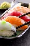 Sushi com varas da costeleta Imagem de Stock Royalty Free