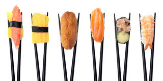 Sushi Combo #1. Five pieces of sushi in a row being held up with black chopsticks isolated on a white background Stock Photography