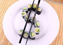 Sushi comme symbole dollar du plat blanc Images stock