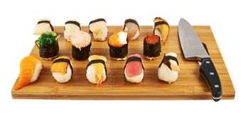Sushi composition over cutting board Royalty Free Stock Photos