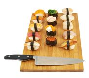 Sushi composition over cutting board Royalty Free Stock Photography