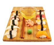 Sushi composition over cutting board Royalty Free Stock Photo