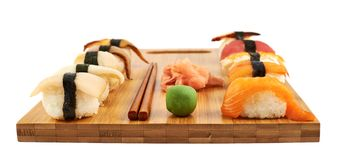 Sushi composition over cutting board Stock Photos