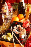Sushi con champán Fotos de archivo