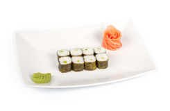 Sushi con la cappasanta americana su una zolla Immagine Stock
