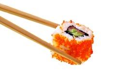 Sushi con los palillos Fotografía de archivo